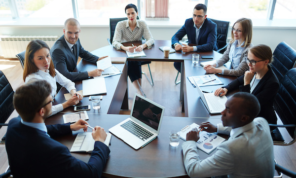 Businesspeople at panel discussion in board room