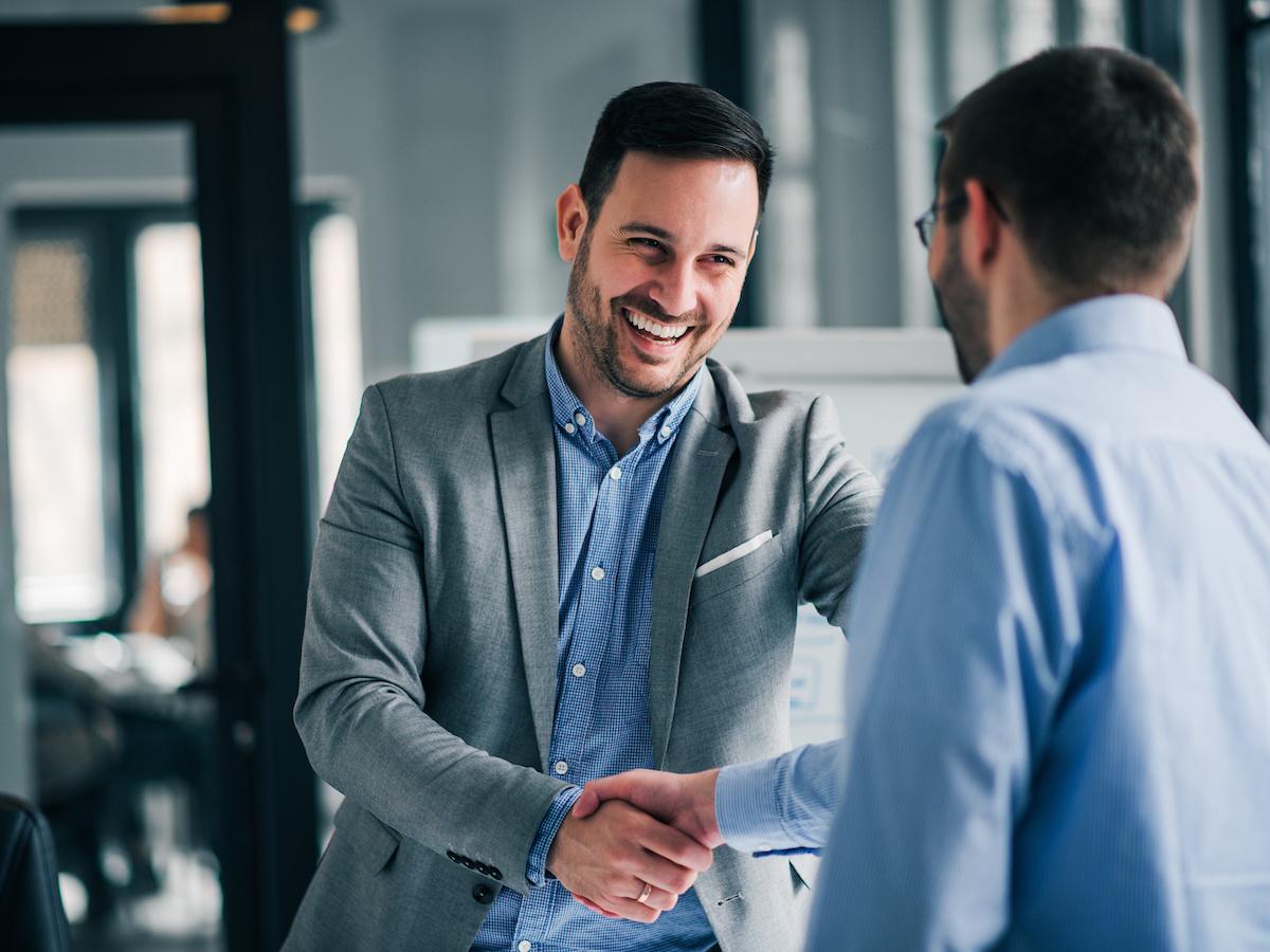 two men business handshake